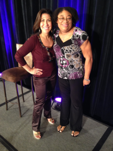 My business mentor, Lisa Sasevich, with me on the stage at her Event Profit Secrets Event